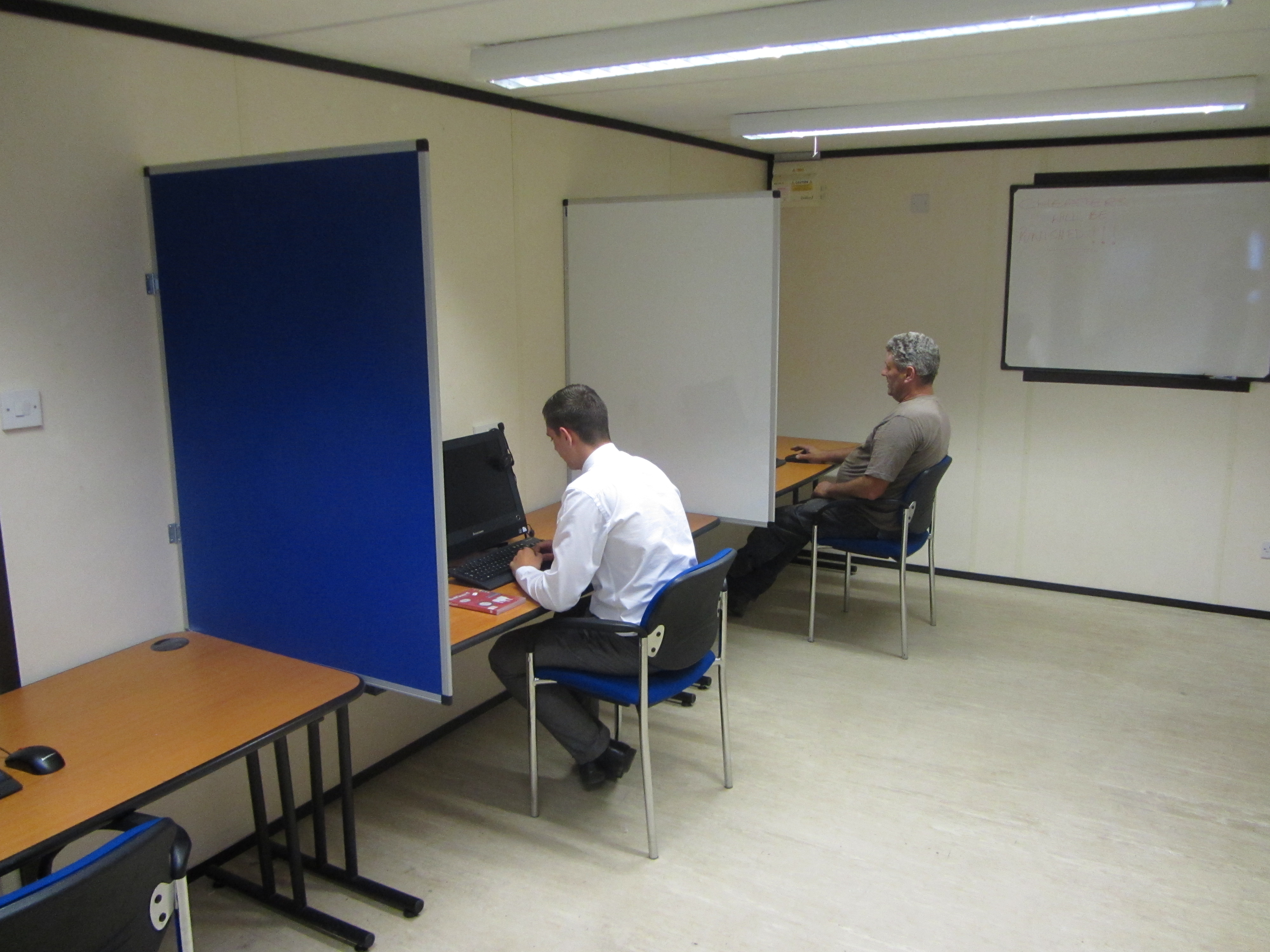 workers in cscs testing room